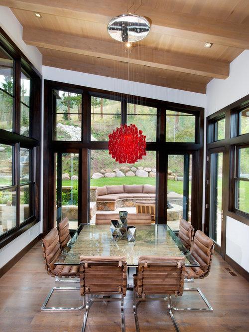 midsized medium tone wood floor great room idea in denver with white walls