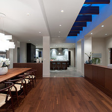Contemporary Dining Room by DEKORA Staging Inc