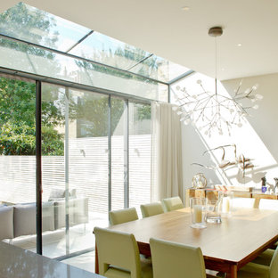 Inspiration for a modern dining room in London with beige walls.