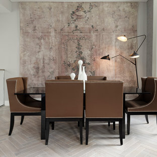 Photo of a medium sized contemporary dining room in London with grey walls, light hardwood flooring and white floors.