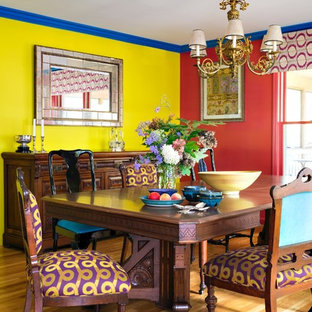 Dining room - eclectic light wood floor and beige floor dining room idea in Other with multicolored walls