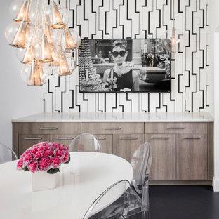 Ispirazione per una sala da pranzo design di medie dimensioni con pareti bianche, pavimento in gres porcellanato e pavimento nero