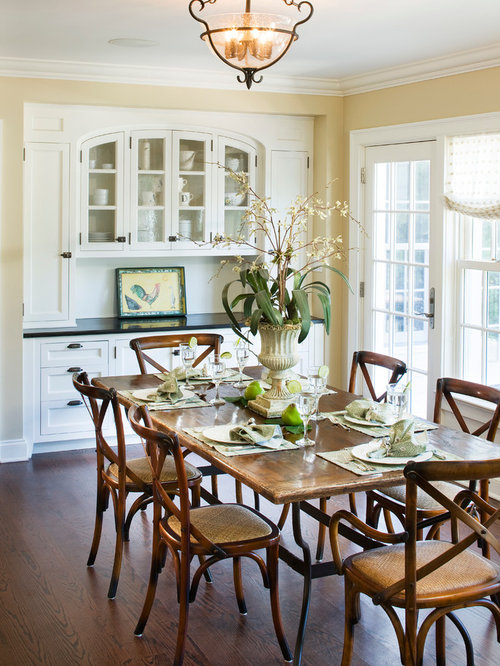 Inspiration For A Timeless Dark Wood Floor Dining Room Remodel In New York  With Beige Walls