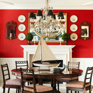 Inspiration for a beach style dining room in New York with red walls and a standard fireplace.
