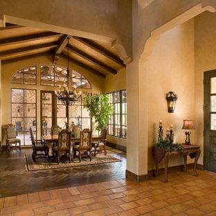 Inspiration for a mediterranean terra-cotta floor dining room remodel in Phoenix