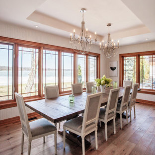 Large coastal kitchen/dining room in Toronto with white walls, light hardwood flooring and no fireplace.