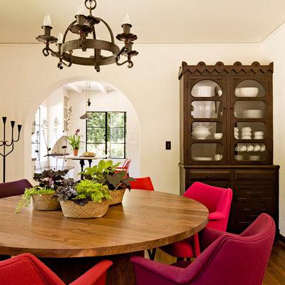 Dining room - mediterranean dark wood floor dining room idea in Portland with white walls