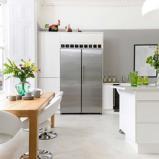 Photo of a medium sized contemporary kitchen/dining room in Other with grey walls, concrete flooring and grey floors.