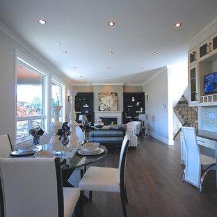 Idee per una sala da pranzo aperta verso il soggiorno chic di medie dimensioni con pareti bianche e parquet scuro