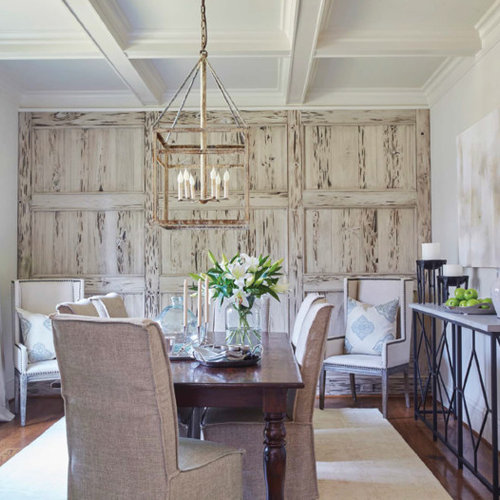 Inspiration For A Large Beach Style Medium Tone Wood Floor And Brown Enclosed Dining Room