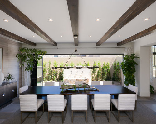 Example Of A Large Transitional Dining Room Design In Phoenix With White Walls