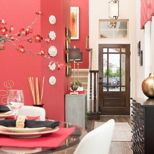 Imagen de comedor actual, de tamaño medio, sin chimenea, con paredes rojas y suelo de baldosas de porcelana