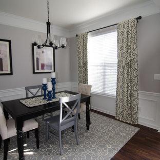 ローリーの小さいトランジショナルスタイルのおしゃれな独立型ダイニング (グレーの壁、ラミネートの床、茶色い床) の写真