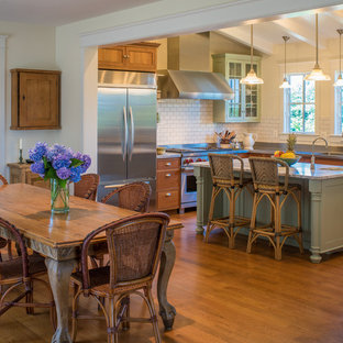 Inspiration for a farmhouse medium tone wood floor and brown floor dining room remodel in DC Metro with beige walls