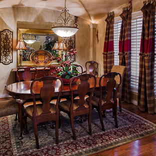 This is an example of a traditional dining room in Houston with beige walls, bamboo floors and brown floor.