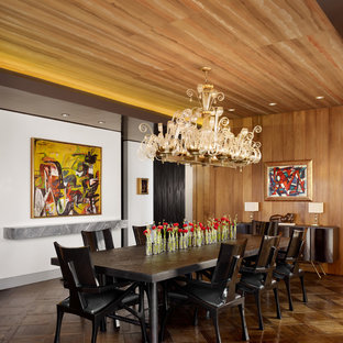 Dining room - 1950s dark wood floor and brown floor dining room idea in Austin with white walls and no fireplace