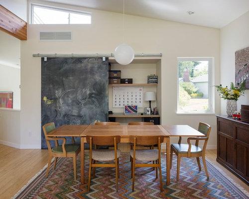 Ex&le of a midcentury modern medium tone wood floor dining room design in Seattle & Chalkboard Barn Door | Houzz Pezcame.Com