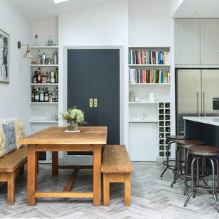 Design ideas for a classic kitchen/dining room in London with white walls, light hardwood flooring and grey floors.
