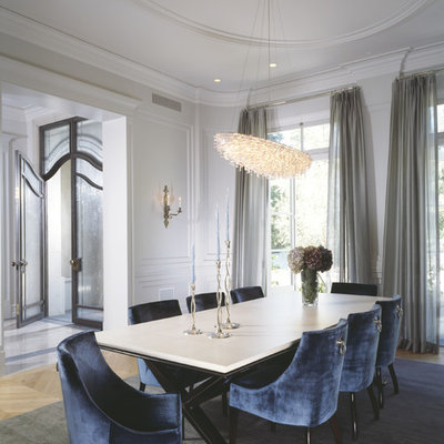 Transitional dining room photo in Los Angeles with white walls