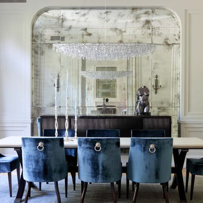 Inspiration for a transitional light wood floor and beige floor dining room remodel in Los Angeles with beige walls