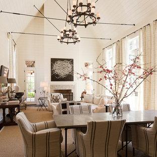 Ispirazione per una grande sala da pranzo chic chiusa con pareti bianche, parquet scuro, camino classico, cornice del camino piastrellata e pavimento beige