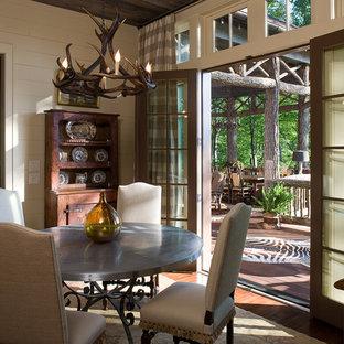 Elegant dark wood floor dining room photo in Atlanta with beige walls