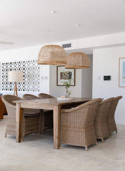 Beach Style Dining Room by PRG Architects