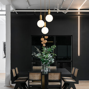 Large urban light wood floor and beige floor dining room photo in New York with black walls and no fireplace