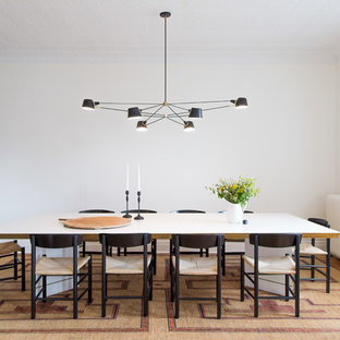Inspiration for a victorian medium tone wood floor enclosed dining room remodel in New York with white walls
