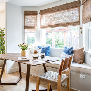 Example Of A Coastal Medium Tone Wood Floor And Brown Kitchen Dining Room Combo