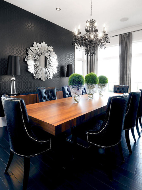 Trendy Black Floor Dining Room Photo In Other With Walls