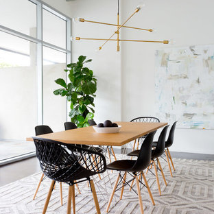 Example of a trendy brown floor dining room design in Los Angeles with white walls