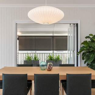 Design ideas for a transitional open plan dining in Brisbane with beige walls, medium hardwood floors and beige floor.