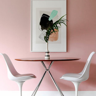 Beau Example Of A Small 1960s Light Wood Floor Dining Room Design In Miami With  Pink Walls
