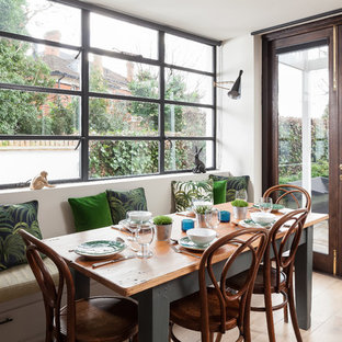 Inspiration for a classic open plan dining room in Kent with white walls and light hardwood flooring.