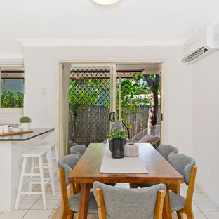 Design ideas for a transitional kitchen/dining combo in Sydney with grey walls and beige floor.