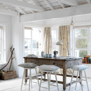 Photo of a beach style dining room in Sussex with white walls and light hardwood flooring.