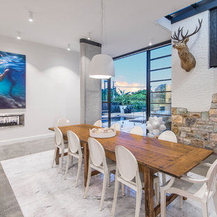 Design ideas for a large country dining room in Brisbane with white walls and grey floor.