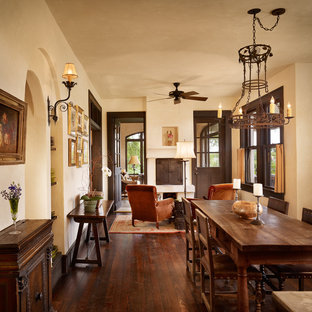 Inspiration for a mediterranean dark wood floor dining room remodel in Austin with beige walls