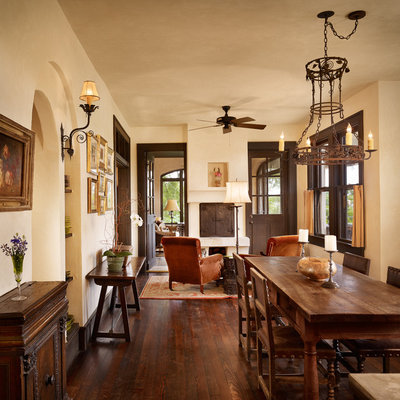 Inspiration for a mediterranean dark wood floor dining room remodel in Austin with beige walls