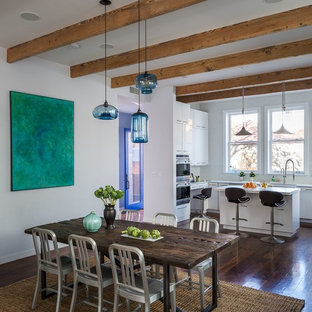 Kitchen/dining room combo - contemporary dark wood floor kitchen/dining room combo idea in New York with white walls