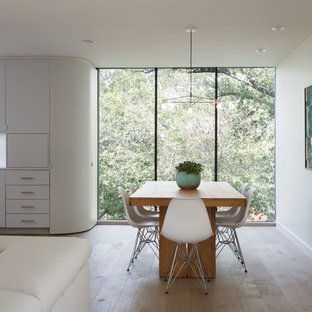 Great room - large scandinavian light wood floor and brown floor great room idea in Austin with white walls and no fireplace