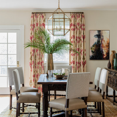 Mid-sized transitional light wood floor and brown floor kitchen/dining room combo photo in Boston with white walls