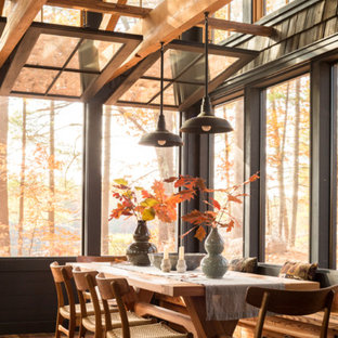 Inspiration for a mid-sized rustic medium tone wood floor and brown floor dining room remodel in Portland Maine