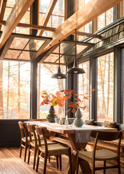 Rustic Dining Room by Winkelman Architecture