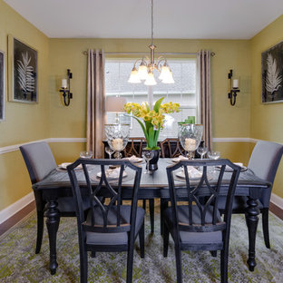 Inspiration for a mid-sized transitional dark wood floor and brown floor enclosed dining room remodel in Philadelphia with yellow walls