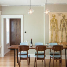 Midcentury Dining Room by Howells Architecture + Design, LLC
