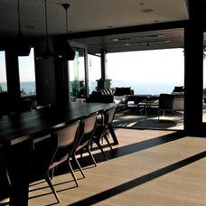 Contemporary Dining Room by Gaile Guevara