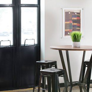 Small urban concrete floor and brown floor great room photo in Milwaukee with white walls
