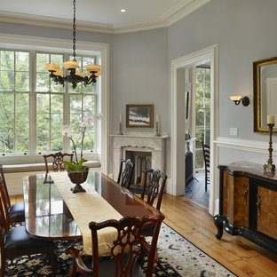 Dining room - traditional dining room idea in Philadelphia with a corner fireplace and gray walls